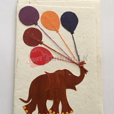 Eco friendly greeting card with elephant playing with balloons